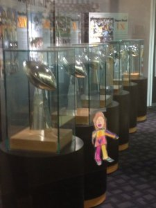 Flat Kaitlyn with 6 Lombardi Trophies